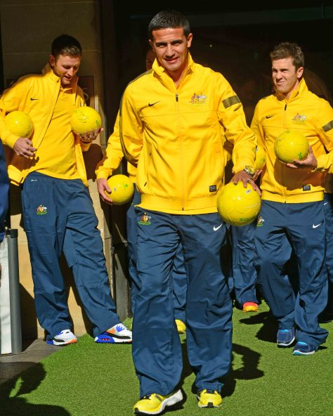 Tim Cahill leads out the Aussie Socceroos from customs house with the Golden Balls for the fans.